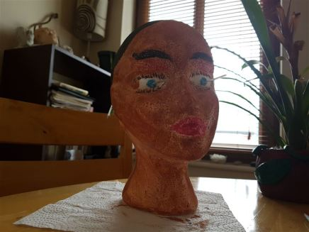 Hair, lips, eyes and eyebrows painted..